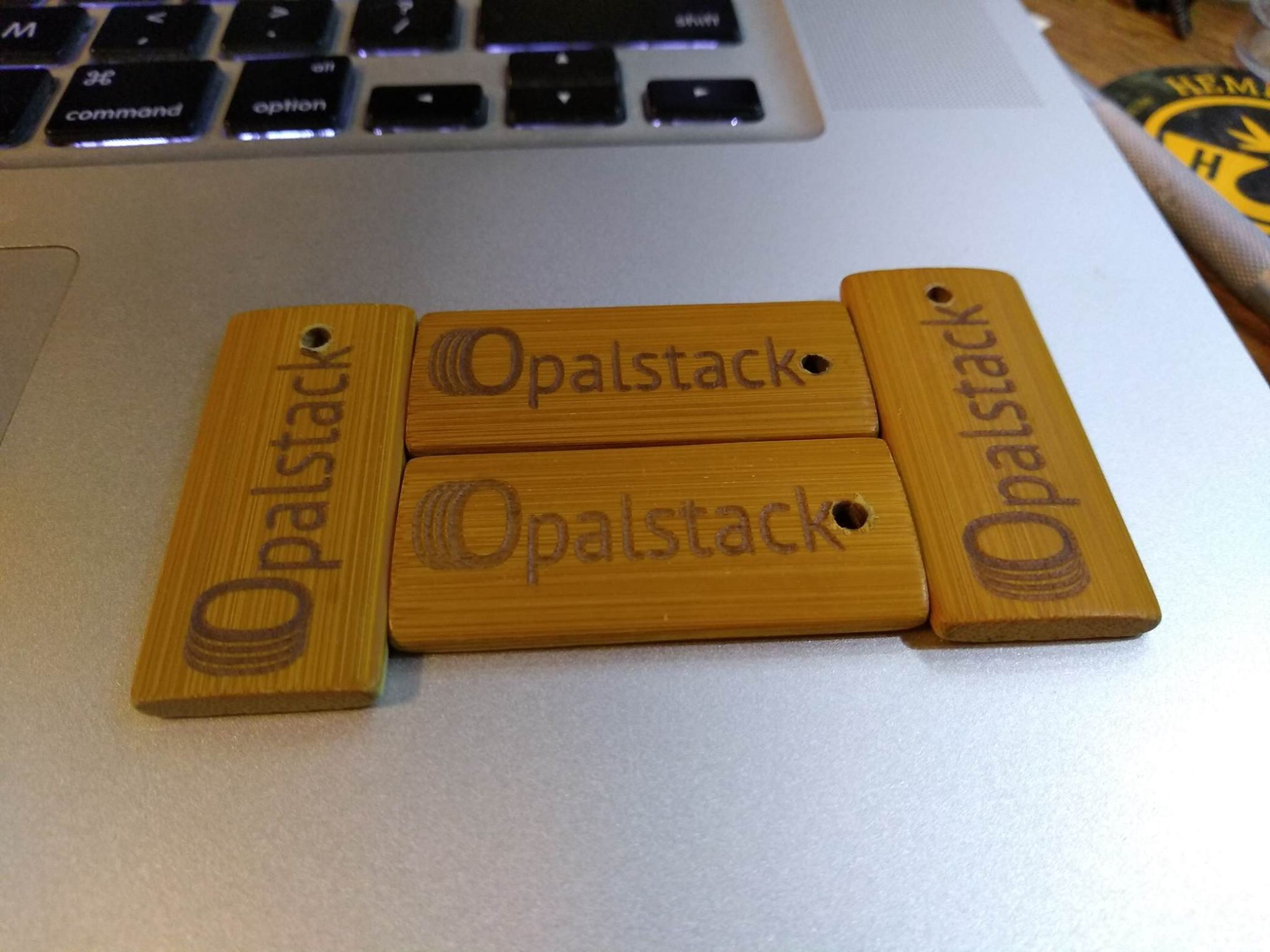 Laser-etched bamboo keychains with the Opalstack logo