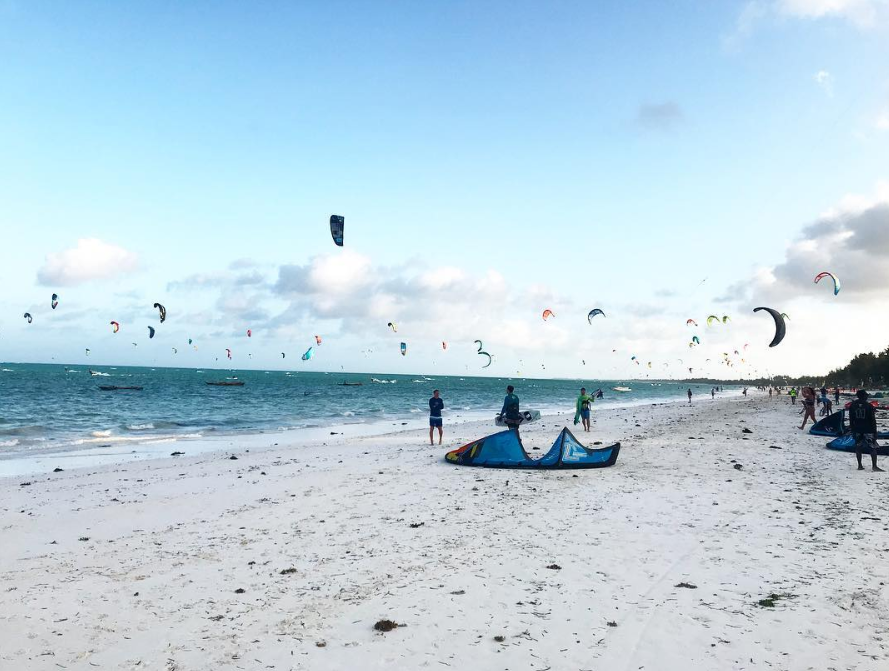 stop being a tourist, staying longer and learning more about a place like a local, kite surfing